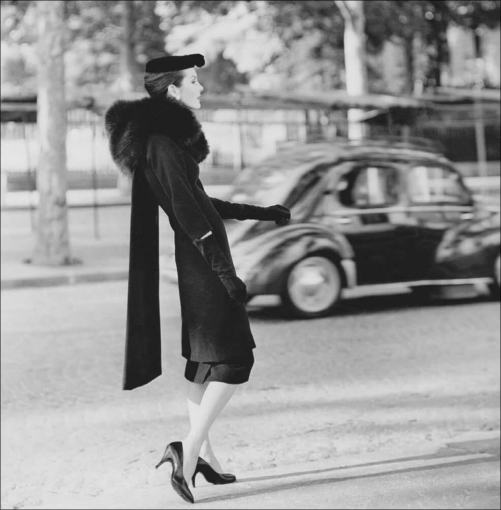 Woman-modeling-Balenciaga-coat-and-dress